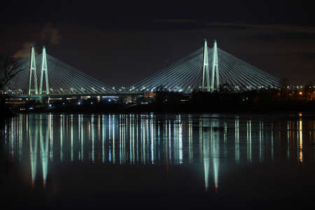 Big cable-stayed bridge of St. Petersburg illuminated at night