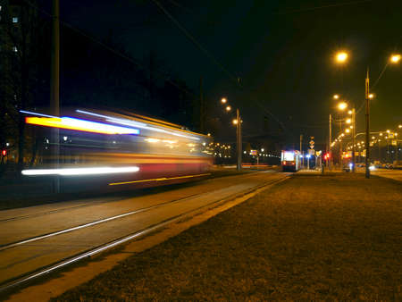 night tram motion blur light trails passing by