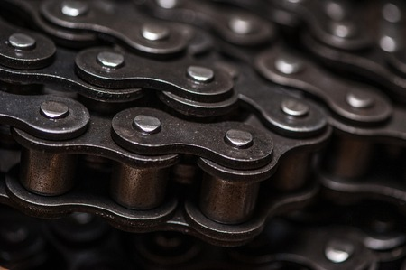Industrial driving roller chain close-up.