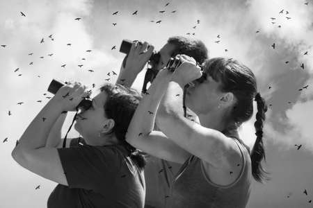 FOROS, CRIMEA, UKRAINE, July, 12,2011 - three people is looking at big binoculars. Birdwatching and spy concept
