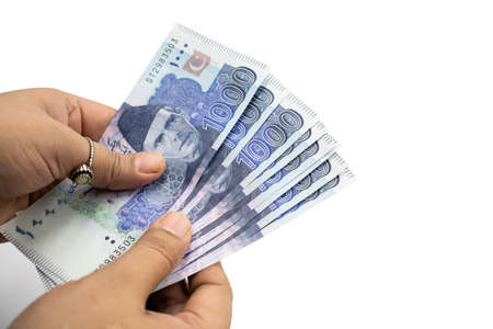 Pakistani Currency, Banknotes holding in hands, Pakistan Bank Rupees