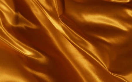 Abstract background gold silk or satin luxury fabric texture