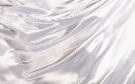 Abstract background white silk or satin luxury fabric texture