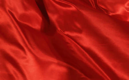 Abstract background red silk or satin luxury fabric texture