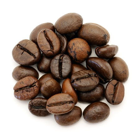beverage in bean: Close-up of coffee beans on white background