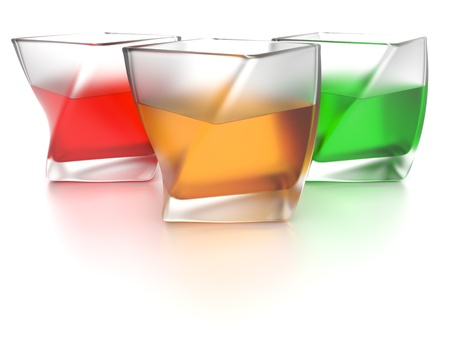 Three frosted glasses of coloured beverages on white background Stock Photo