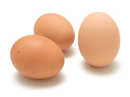 Three eggs isolated on white background Stock Photo