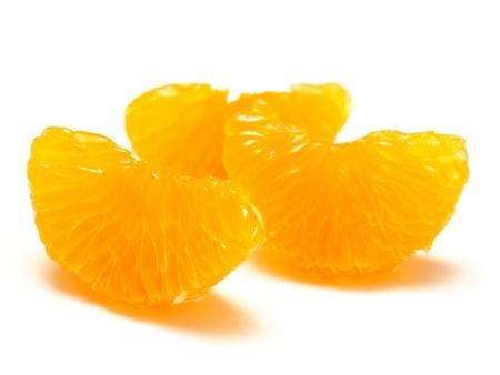 carpel: Peeled mandarin orange segments on white background