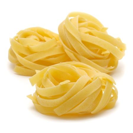 Italian pasta  tagliatelle  isolated on white background