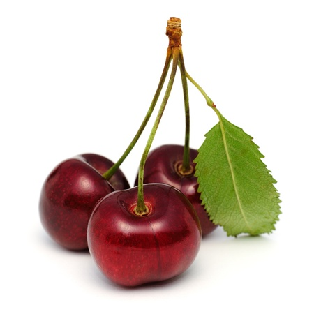 Three cherries isolated on white background with clipping path