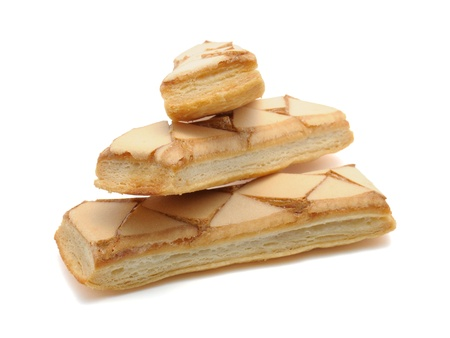 Iced puff pastry biscuits  sfogliatine glassate  isolated on white background with clipping path