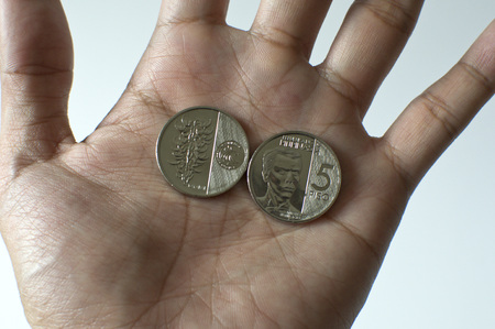 A newly issued five peso coins of Banko Sentral ng Pilipinas