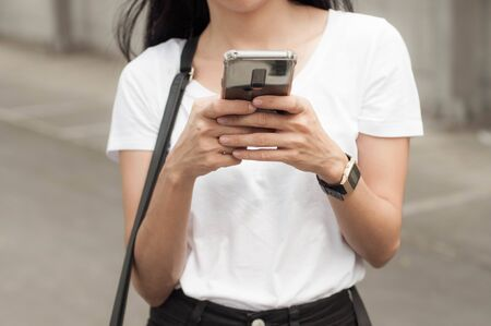 A young woman is using a smart phone