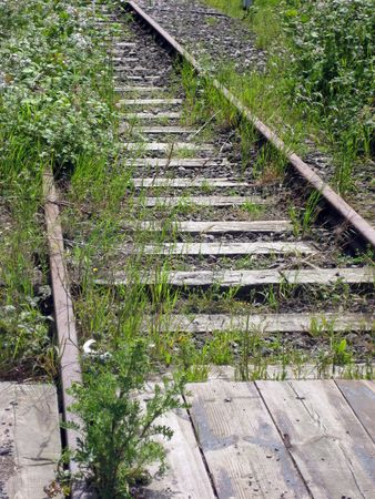 disused: Old tracks and crossing of disused railway line Stock Photo