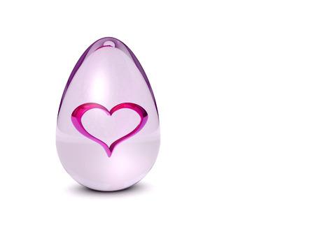 heart inside of glass egg on white background