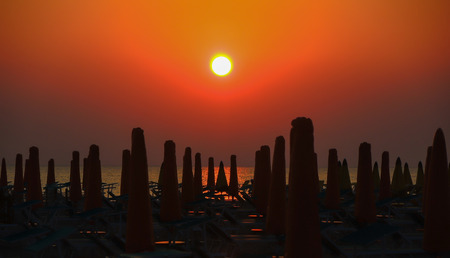 adriatico: Sunrise - Adriatic sea - sunshades Stock Photo
