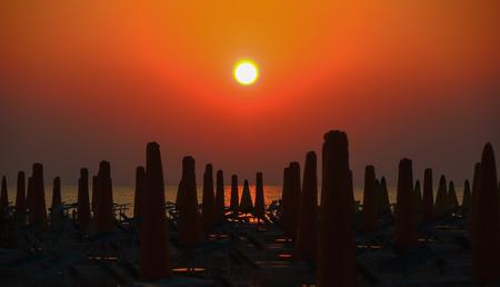 sunshades: Sunrise - Adriatic sea - sunshades Stock Photo
