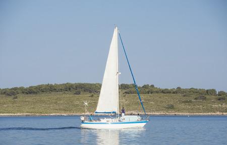 menorca: Port de Fornells - Menorca - Spain - Boats approcing the harbor Stock Photo