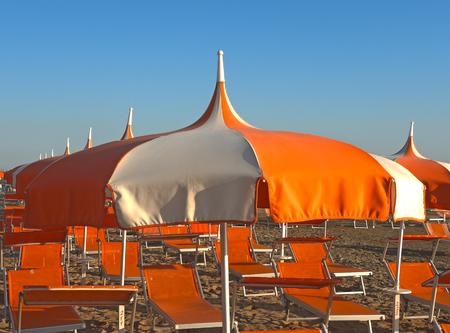 Umbrellas and gazebos on Italian sandy beaches. Adriatic coast. Pictures taken at sunrise Stock Photo