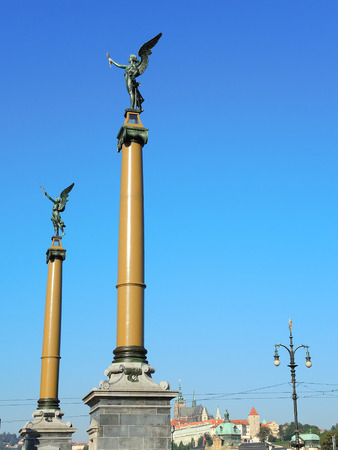 angel de la independencia: columns with angels at the beginning of the bridge in Prague - Czech Republic