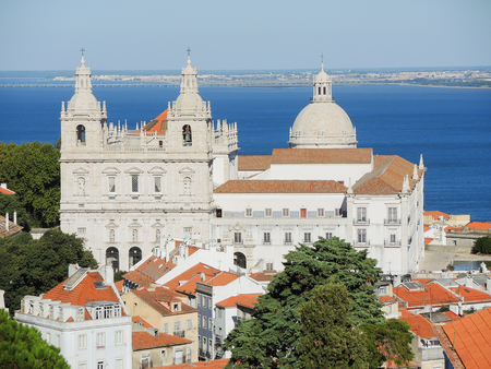 Lisbon, Portugal. Viewpoint Largo das Portas do Sol, a balcony opens onto the river offering truly spectacular views over Alfama. Lookout on the Monastery of Sao Vicente de Flora