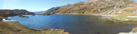 mountaintop: San Bernardino mountain pass, Switzerland. Fantastic view at Moesola alpine lake with blue sky.