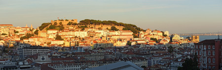 Lisbon, Portugal. Landscape at the sunset from Viewpoint called Mirodouro from San Pedro de Alcantara. A terrace offering a spectacular panoramic view of the castle and central Lisbon. Stock Photo
