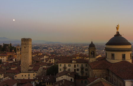 po valley: Bergamo - Old city (Citta Alta). One of the beautiful city in Italy. Lombardy. Evening sunset. Landscape on the old city, Cathedral, clock towers and the Po Valley.