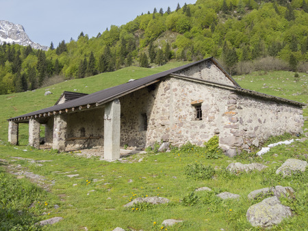 grazing cows: Mountain barn used by shepherds During the summer season for grazing cows and sheep Stock Photo