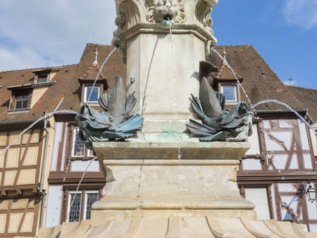 romantic places: Colmar, Alsace, France, Medieval old town. Half timbered houses. The fountain.