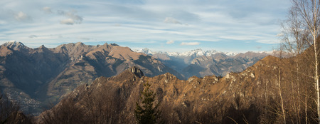 formic: Great landscape on the Orobie Alps in fall season. View of the highest mountains including Arera. Panorama from Farno Mountain, Seriana Valley, Bergamo, Italy.