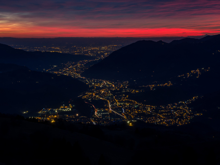 formic: Fiery sunset from mountain pick in a cloudy evening. Fall season. Orobie mountains. Italian Alps.