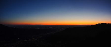 glazes: Fiery sunset from mountain pick with thin glazes in the evening sky. Fall season. Orobie alps. The summit of Mount Rena. Bergamo Italy.