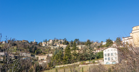 That view of the hills surround Bergamo During a day with clear blue sky, Orobie area, Lombardy, Italy Stock Photo
