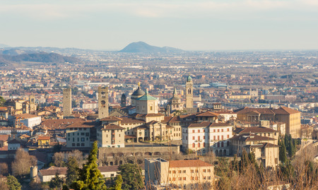 episcopal: Bergamo - Old city (Citta Alta). One of the beautiful city in Italy. Lombardy. Landscape of the old city from San Vigilio hill During a beautiful day. Stock Photo