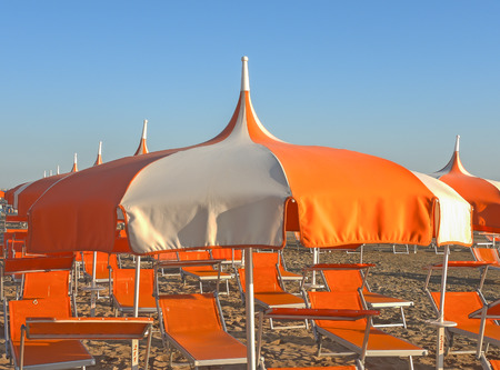 Umbrellas and gazebos on Italian sandy beaches. Adriatic coast. Emilia Romagna region.