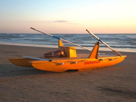 Rescue boat on Italian beach. Adriatic sea. Emilia Romagna. Italy Stock Photo
