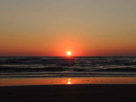 adriatico: Fiery sunrise at Italian beach. Summer season. Emilia Romagna region. Adriatic sea. Italy