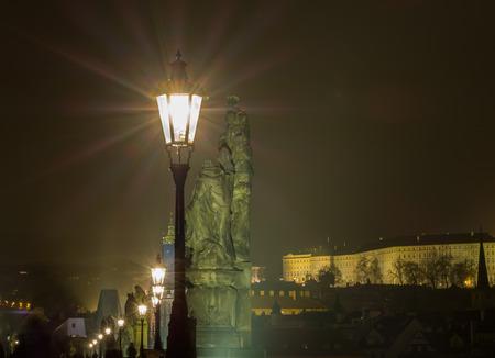 Prague, Czech Republic, walking on the Charles Bridge in the night.