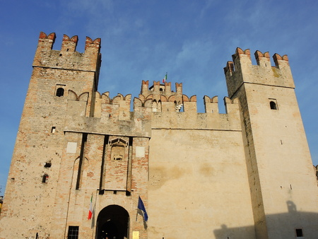 crenellated: The Scaliger Castle is a rare example of medieval fortification port, Which Was used by the Scaliger fleet. It is the only point of access to the historic center of Sirmione.