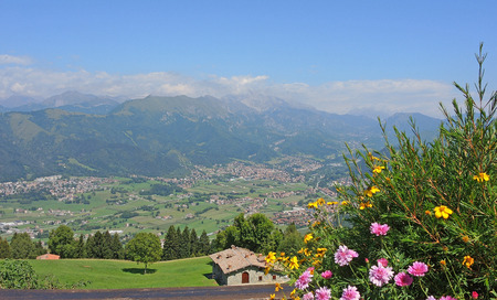 Landscape on the town of Rovetta from the mountain lodge called San Lucio Stock Photo