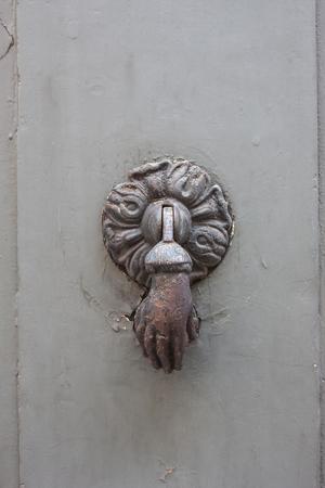 Doorknocker on the front door of the Italian building