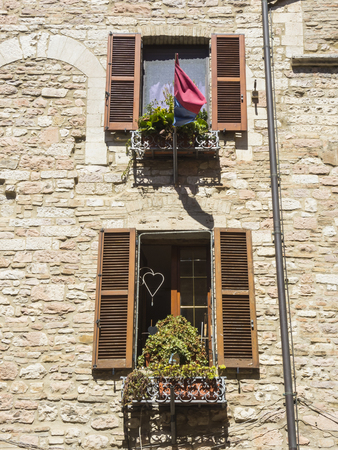 windows frame: Wooden shutter on a historic house in an Italian city Stock Photo