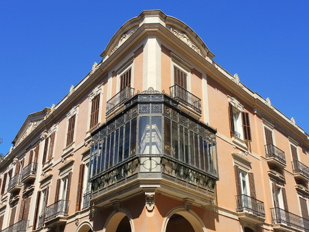 Palma de Mallorca, Spain. The typical balconies on the facades of the buildings and houses in the old city center Stock Photo