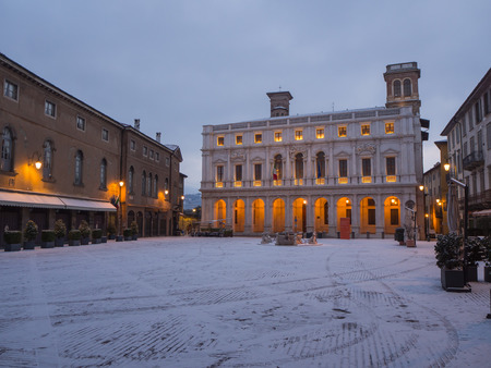 Bergamo, Italy. The old city (Citta Alta). One of the beautiful city in Italy. Lombardy. The old main square and the public library after a snow fall Editorial