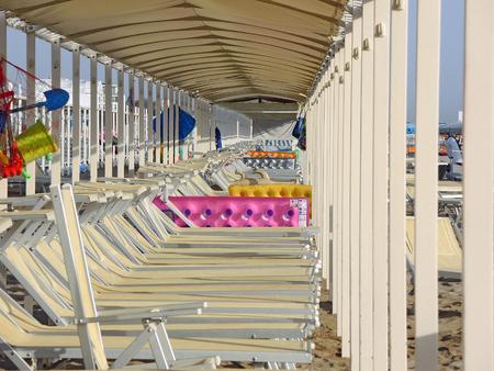 Beach umbrellas, gazebos and sun beds at Italian sandy beaches. Adriatic coast. Emilia Romagna region Stock Photo