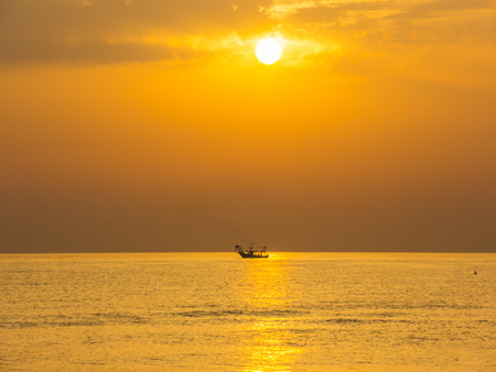 Fishing boats pull their nets at the sunrise. Adriatic cost Emilia Romagna. italy
