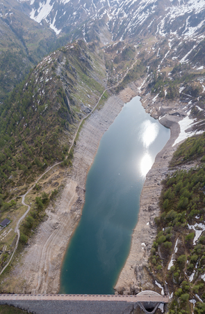 Aerial drone view of the Lake Fregabolgia in Alpine artificial lake. Italian Alps. italy