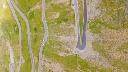 Road to the Stelvio mountain pass in Italy. Up and down amazing aerial view