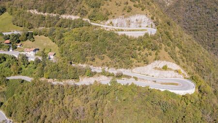 Done aerial view of the road in Italy from the village of Nembro to Selvino.